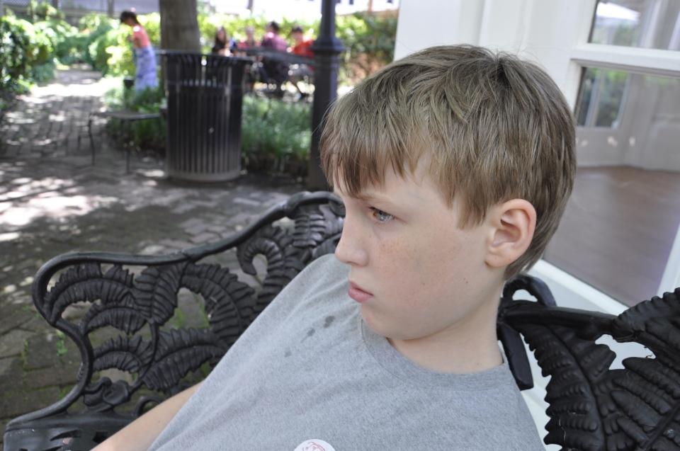Sulking.  He wants a gun.